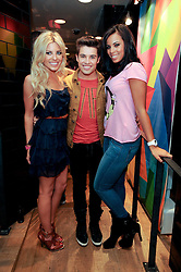 Left to right, MOLLIE KING, JOE McELDERRY and ROCHELLE WISEMAN at a party to celebrate the Firetrap Watches and Kate Moross Collaboration Launch, held at Firetrap, 21 Earlham Street, London, UK on 13th October 2010.