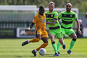 Cambridge United's Rushian Hepburn-Murphy(9) and Forest Green Rovers Carl Winchester(7) during the EFL Sky Bet League 2 match between Forest Green Rovers and Cambridge United at the New Lawn, Forest Green, United Kingdom on 22 April 2019.