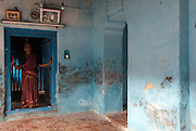 Woman at entrance to the courtyard of her home in Nagapattinam.