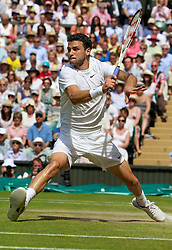 02.07.2014, All England Lawn Tennis Club, London, ENG, ATP Tour, Wimbledon, im Bild Grigor Dimitrov (BUL) during the Gentlemen's Singles Quarter-Final match on day nine // during the Wimbledon Championships at the All England Lawn Tennis Club in London, Great Britain on 2014/07/02. EXPA Pictures © 2014, PhotoCredit: EXPA/ Propagandaphoto/ David Rawcliffe<br /> <br /> *****ATTENTION - OUT of ENG, GBR*****