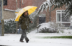 © Licensed to London News Pictures. 14/01/2013. London, United Kingdom ..A man uses an umbrella to shield himself against the heavy snow in Leicester...Photo credit : Chris Winter/LNP