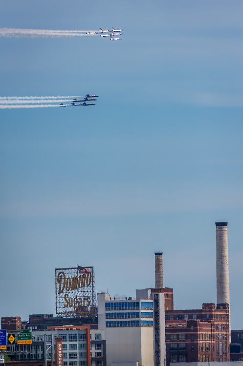 The Navy's Blue Angels and the Air Force's Thunderbirds fly over the Baltimore, Maryland skyline as a part of their salute to healthcare workers during the coronavirus pandemic.