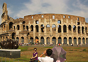 Tourists outside the Colosseum, Rome, Italy