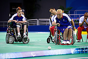Photo: © Graham Bool Photography 2008. Moral rights asserted..Tel 44 (0)1371 851189.Mob 44 (0)7958 338448.Email grahambool@mac.com..The BEIJING 2008 Paralympic Games. September 6th - 17th 2008...NIgel Murray of Great Britain competes in the Gold medal final of the mixed team BC 1 - 2 on the 12th September 2008..The British team is David Smith, Dan Bentley, Nigel Murray and Zoe Robinson..The Portugese team is Cristina Goncalves, Fernando Ferriera, Joao Paulo Fernandes and Antonio Marques of Portugal