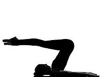beautiful caucasian tall woman ballet dancer halasana Shoulder Stand yoga pose full length on studio isolated white background
