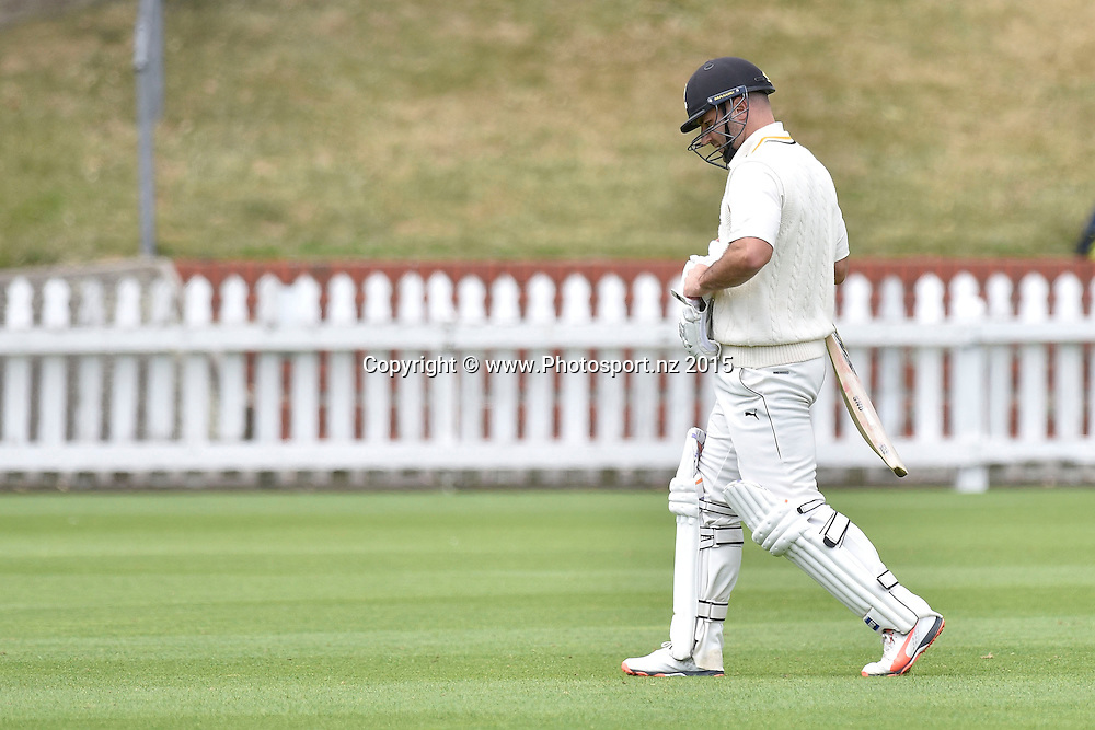 Luke Woodcock of the Firebirds walks from the field after being caught with LBW during the Plunket Shield cricket match -between the Wellington Firebirds and Otago Volts on Thursday 17 December 2015 at the Basin Reserve, Wellington. Copyright Photo: Marty Melville  / www.photosport.nz