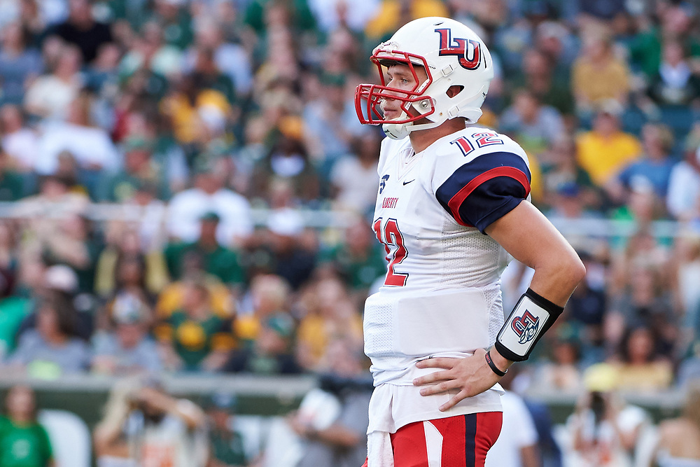 WACO, TX - SEPTEMBER 2:  Stephen Calvert #12 of the Liberty Flames looks on against the Baylor Bears during a football game at McLane Stadium on September 2, 2017 in Waco, Texas.  (Photo by Cooper Neill/Getty Images) *** Local Caption *** Stephen Calvert
