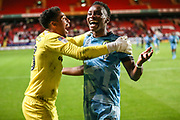 Forest Green Rovers Shawn McCoulsky(21) hits the winning penalty and celebrates with Forest Green Rovers goalkeeper Joe Wollacott(13) during the EFL Cup match between Charlton Athletic and Forest Green Rovers at The Valley, London, England on 13 August 2019.