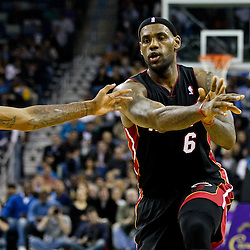 November 5, 2010; New Orleans, LA, USA;  Miami Heat small forward LeBron James (6) passes the ball as New Orleans Hornets small forward Trevor Ariza (1) defends during a game at the New Orleans Arena. The Hornets defeated the Heat 96-93. Mandatory Credit: Derick E. Hingle
