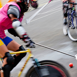 London, UK - 24 August 2012: blurred image of bikes and mallets during the Hell's Belles Vol 2, Ladies Bike Polo Tournament in Bethnal Green Gardens.