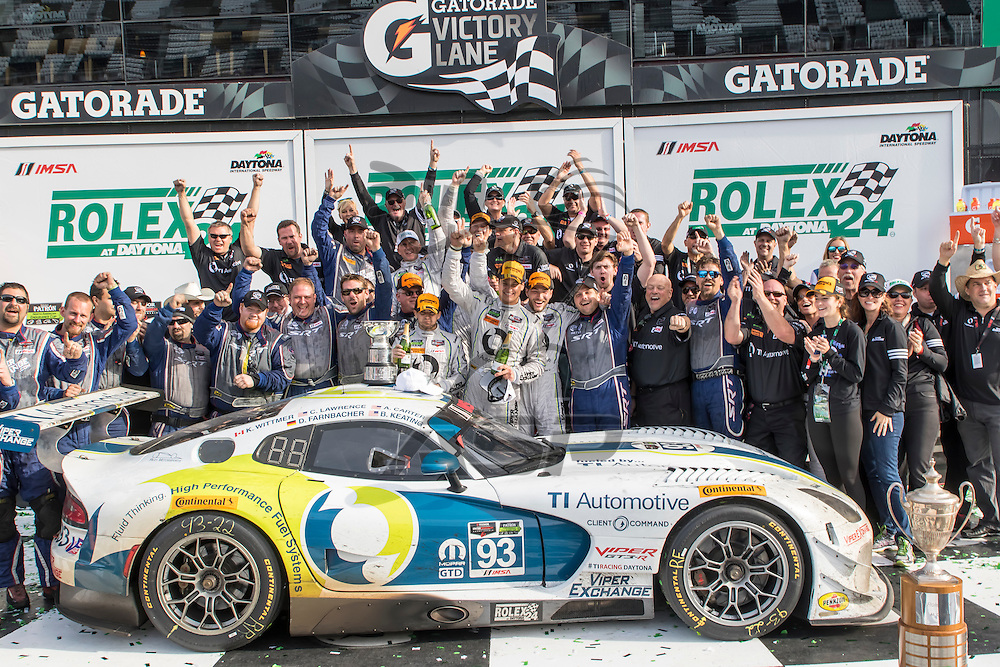 Daytona Beach, FL - Jan 25, 2015:  The Riley Motorsports Dodge Viper SRT crew celebrate after winning the Rolex 24 at Daytona International Speedway in Daytona Beach, FL.