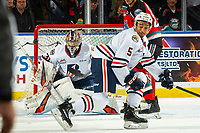 KELOWNA, BC - OCTOBER 12: Goalie Dylan Garand #31 keeps his eye on the incoming puck as Montana Onyebuchi #5 of the Kamloops Blazers tries to block against the Kelowna Rockets at Prospera Place on October 12, 2019 in Kelowna, Canada. (Photo by Marissa Baecker/Shoot the Breeze)