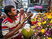 "22 OCTOBER 2015 - YANGON, MYANMAR: A Hindu man in Yangon perfumes the air with incense during a Navratri procession to the Sri Kali Temple. Navratri, literally ""nine nights"" is a Hindu festival devoted to the Goddess Durga. Navratri festival combines ritualistic puja (prayer) and fasting. Navratri in India follows the lunar calendar and is celebrated in September/October as Sharad Navratri. It's widely celebrated in countries in Southeast Asia that have large Hindu communities, including Myanmar (Burma). Many of Myanmar's Hindus are descendants of Indian civil servants and laborers who came to Myanmar when it was the British colony of Burma.   PHOTO BY JACK KURTZ"