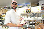 Justin Zaslow of Pierre's Chocolates hold a line of chocolate featuring cacao from Central and South America at Pierre's Chocolates Monday October 26, 2015 in New Hope, Pennsylvania. Pierre's was one of six U.S. chocolatiers invited to explore cacao fields, dairy farms and sugar cane plantations in Ecuador. (Photo by William Thomas Cain)