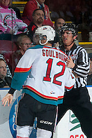 KELOWNA, CANADA - APRIL 25: Bevan Mills, linesman, takes Tyrell Goulbourne #12 of the Kelowna Rockets to the penalty box against the Portland Winterhawks on April 25, 2014 during Game 5 of the third round of WHL Playoffs at Prospera Place in Kelowna, British Columbia, Canada. The Portland Winterhawks won 7 - 3 and took the Western Conference Championship for the fourth year in a row earning them a place in the WHL final.  (Photo by Marissa Baecker/Getty Images)  *** Local Caption *** Bevan Mills; Tyrell Goulbourne;