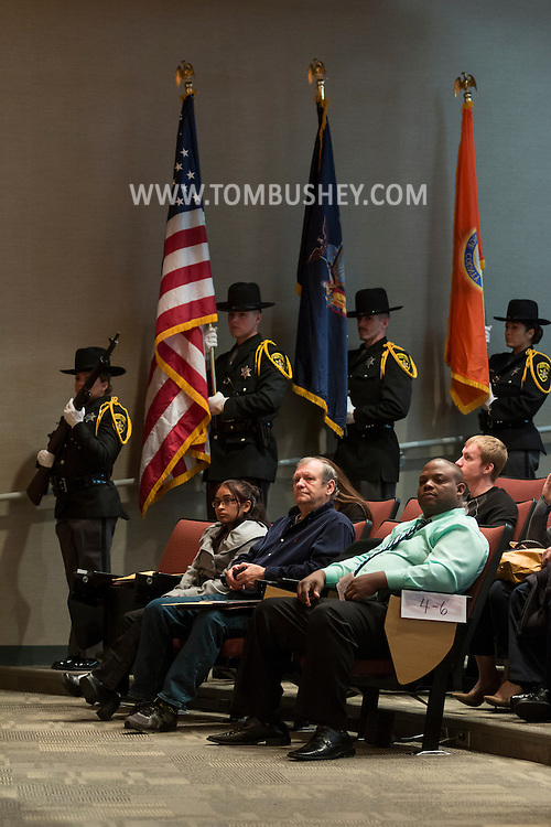 Goshen, New York - People wait for the start of a Naturalization ceremony at the Orange County Emergency Services Center on Nov. 17, 2016. A color guard from the Orange County Sheriff's Department is in the background.