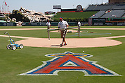 ANAHEIM, CA - JULY 21:  The grounds crew works on the infield prior to the Los Angeles Angels of Anaheim game against the Texas Rangers on July 21, 2011 at Angel Stadium in Anaheim, California. The Angels won the game in a 1-0 shutout. (Photo by Paul Spinelli/MLB Photos via Getty Images)