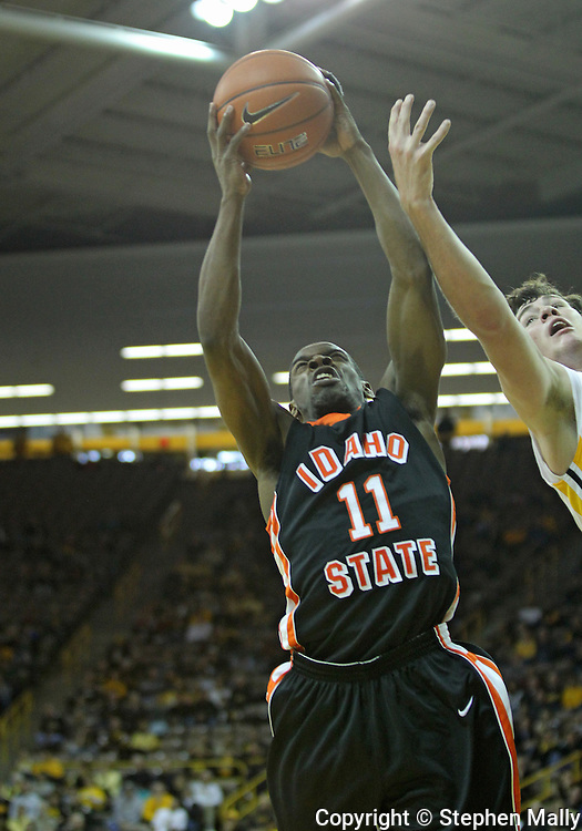 December 04 2010: Idaho State Bengals guard Kenny McGowen (11) pulls in a rebound during the first half of their NCAA basketball game at Carver-Hawkeye Arena in Iowa City, Iowa on December 4, 2010. Iowa won 70-53.