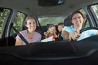 Family with two children (5-6) in car interior portrait
