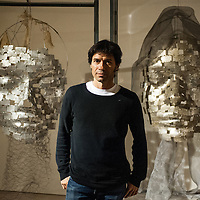 London, UK - 2 September 2014: Artist Xavier Mascaró poses next to his works 'Masks'. Xavier Mascaró's first UK solo exhibition will run from 3 September until 5 October at Saatchi Gallery.