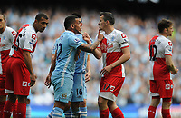Football - Premier League - Manchester City vs. Queens Park Rangers<br /> Joey Barton of Queens Park Rangers argues with Manchester City's Carlos Tevez following the foul that earns Barton a straight red card at the Etihad Stadium, Manchester