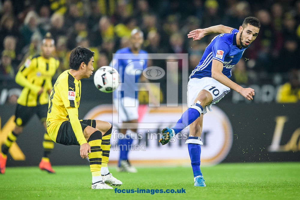 Shinji Kagawa of Borussia Dortmund and Nabil Bentaleb of FC Schalke 04 during the Bundesliga match at Signal Iduna Park, Dortmund<br /> Picture by EXPA Pictures/Focus Images Ltd 07814482222<br /> 29/10/2016<br /> *** UK &amp; IRELAND ONLY ***<br /> EXPA-EIB-161030-0026.jpg