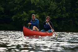 A couple canoes on the Androscoggin River in Turner, Maine.