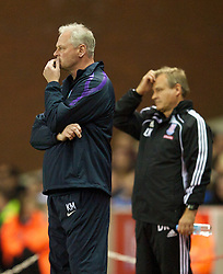 STOKE, ENGLAND - Monday, September 13, 2010: Aston Villa's caretaker manager Kevin MacDonald and Stoke City's assistant manager Dave Kemp during the Premiership match at the Britannia Stadium. (Photo by David Rawcliffe/Propaganda)