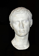 The Emperor Augustus 63BC-14AD the first Roman emperor.  He became Gaius Julius Caesar Octavianus through adoption by Caesar in his will (44BC) and later received the name Augustus in recognition of his services and position. At the time of Caesar's assassination Augustus was a student at Apollonia in Illyricum, but returned at once to Italy to claim his inheritance.