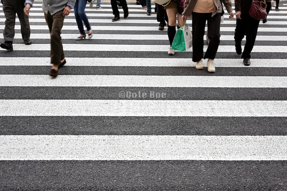 people crossing at a zebra crossing Tokyo Japan