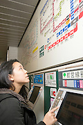 A young Japanese lady in the Tokyo subway.