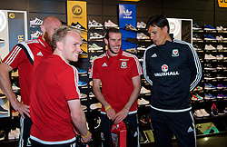 CARDIFF, WALES - Thursday, June 2, 2016: Wales' Jonathan Williams, Gareth Bale and manager Chris Coleman during a visit to a JD Sports store in Llantrisant. (Pic by Ian Cook/Propaganda)