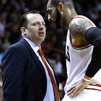 29 January 2012: Chicago Bulls head coach Tom Thibodeau talks to Chicago Bulls power forward Carlos Boozer (5) during the Miami Heat 97-93 victory over the Chicago Bulls at the AmericanAirlines Arena, Miami, Florida, USA.