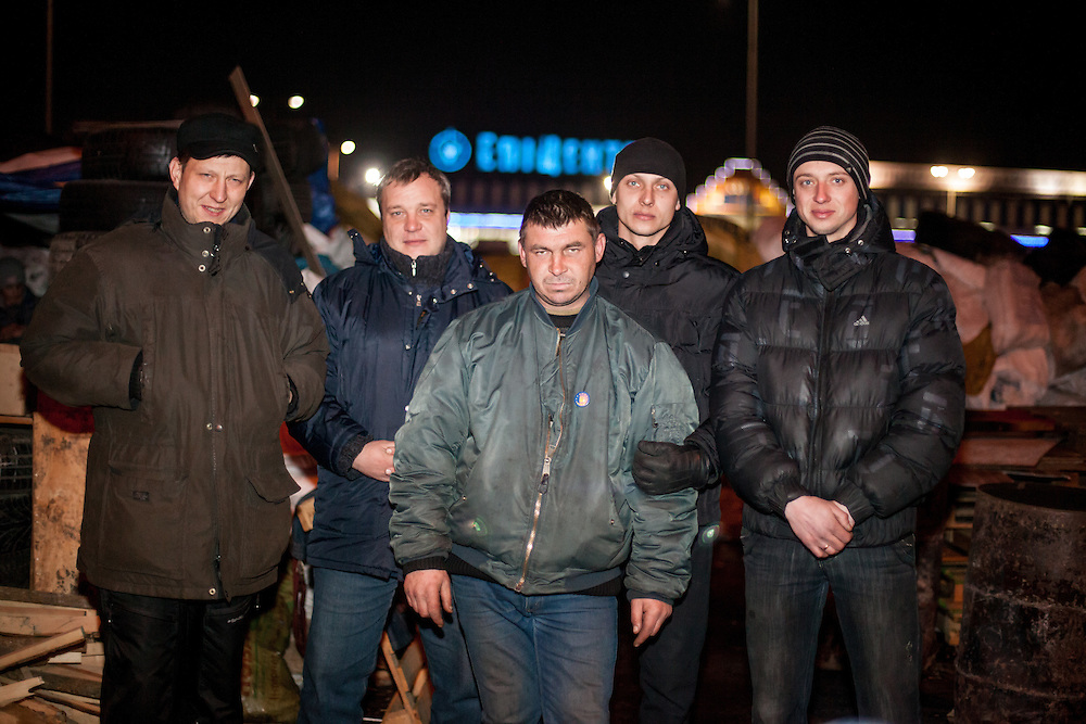 "The core group of activists from left Oleg, Dimi, ""Bosch"", Andrej and his brother in front of the barricades blocking a building supplies store named ""Epicenter"" in the city of Lviv, Ukraine."