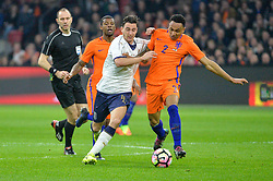 March 28, 2017 - Amsterdam, Netherlands - Matteo Darmian from Italy  is tackled by Kenny Tete from the Netherlands during the friendly match between Netherlands and Italy on March 28, 2017 at the Amsterdam ArenA in Amsterdam, Netherlands. (Credit Image: © Andy Astfalck/NurPhoto via ZUMA Press)