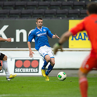 Rosenborg v St Johnstone....18.07.13  UEFA Europa League Qualifier.<br /> GWION EDWARDS IS CLOSED DOWN BY TORE REGINIUSSEN<br /> Picture by Graeme Hart.<br /> Copyright Perthshire Picture Agency<br /> Tel: 01738 623350  Mobile: 07990 594431