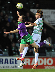 Yeovil Town's Sam Foley challenges for the high ball with Bristol City's Luke Freeman - Photo mandatory by-line: Harry Trump/JMP - Mobile: 07966 386802 - 10/03/15 - SPORT - Football - Sky Bet League One - Yeovil Town v Bristol City - Huish Park, Yeovil, England.