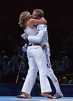 Brice Guyart (France) celebrates winning the Mens Foil Gold Medal with his wife/girlfriend ?. Fencing, Athens Olympics, 16/08/2004. Credit: Colorsport / Matthew Impey DIGITAL FILE ONLY