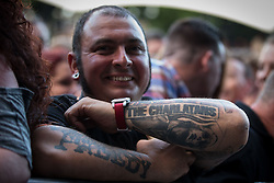 """© Licensed to London News Pictures . 04/07/2015 . Manchester , UK . A man with a The Charlatans tattoo . Fans at the Castlefield Bowl as part of the """" Summer in the City """" festival in Manchester. Photo credit : Joel Goodman/LNP"""