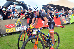 PAARL SOUTH AFRICA - MARCH 23: Stage winners Fabian Rabensteiner and Michele Casagrande celebrate on the 70km final day, stage 7 on March 23, 2018 Wellingtion to Paarl, South Africa. Mountain bikers gather from around the world to compete in the 2018 ABSA Cape Epic, racing 8 days and 658km across the Western Cape with an accumulated 13 530m of climbing ascent, often referred to as the 'untamed race' the Cape Epic is said to be the toughest mountain bike event in the world. (Photo by Dino Lloyd)