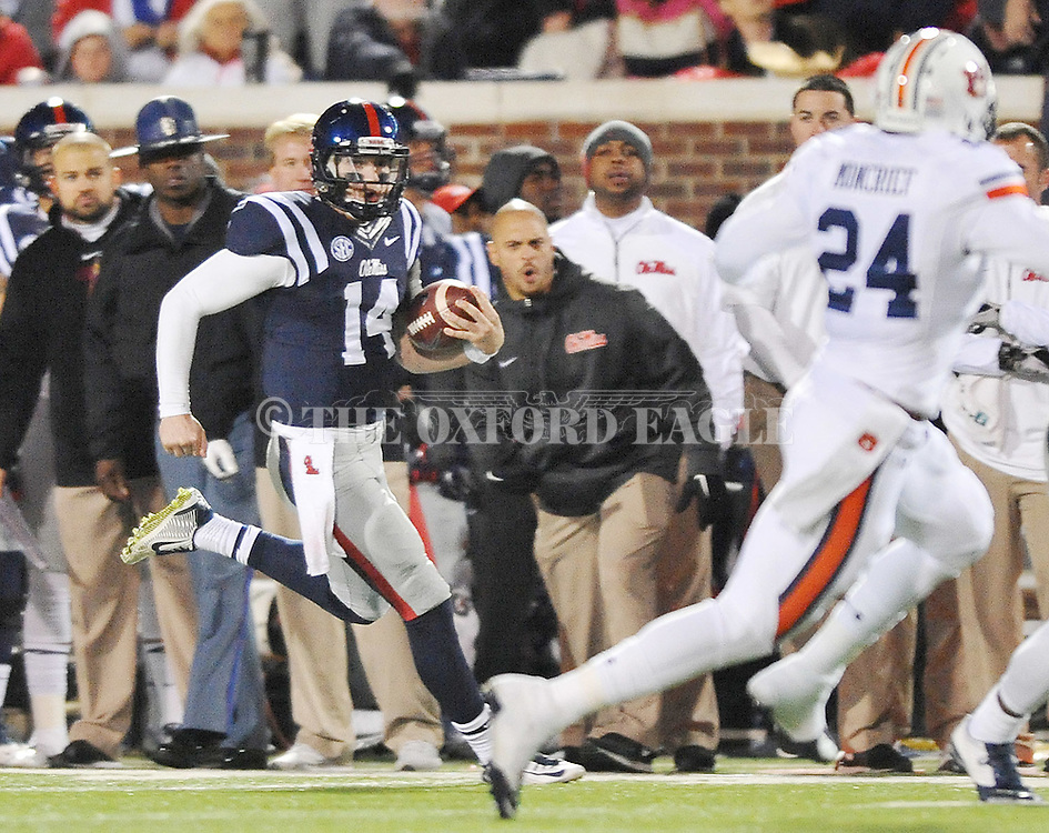 Ole Miss' quarterback Bo Wallace (14) runs down the sidelines on a long play vs. Auburn at Vaught-Hemingway Stadium in Oxford, Miss. on Saturday, November 1, 2014. (AP Photo/Oxford Eagle, Bruce Newman)