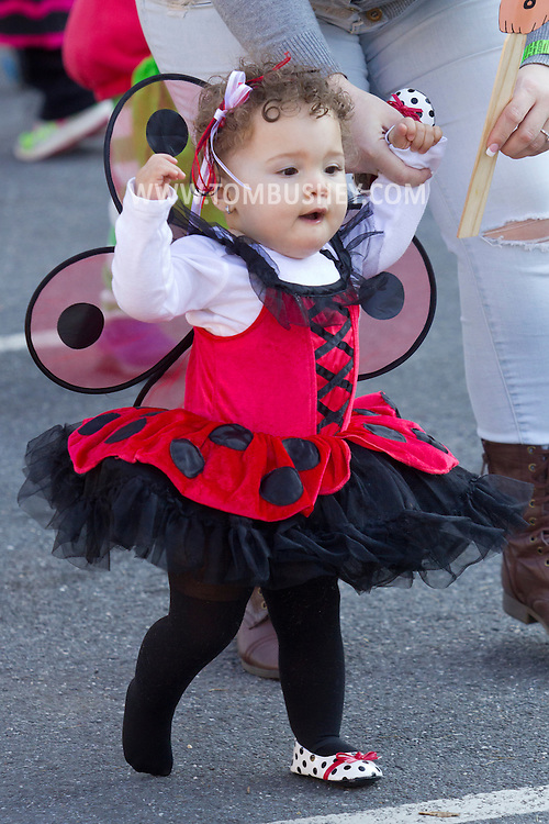 Middletown, New York  - A young girl takes part in the costume contest during the Halloween Fall Festival at the Middletown YMCA's Center for Youth Programs on Oct. 25, 2014.