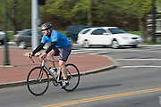 A participant bikes during the O'Bleness Race for a Reason Triathlon Saturday, April 27, 2013. The triathlon included a 500mm Serpentine Swim at the Ohio University Aquatic Center, a 15 mile bike ride to the Plains and back and then a 5k run that finished at Tailgreat Park across from Peden Stadium. . Race for a Reason, Race 4 A Reason, Annual Events, Events, Students, Faculty & Staff