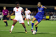 AFC Wimbledon defender George Francomb (7) taking on Milton Keynes Dons midfielder Gboly Ariyibi (7) during the EFL Sky Bet League 1 match between AFC Wimbledon and Milton Keynes Dons at the Cherry Red Records Stadium, Kingston, England on 22 September 2017. Photo by Matthew Redman.