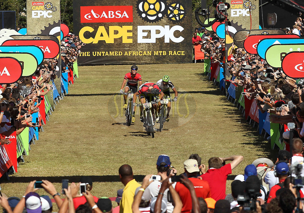 Philip Buys of Scott Factory Racing, Jose Hermida (unsighted), Rudi van Houts of Multivan Merida and Matthys Beukes of Scott Factory Racing sprint for the line for stage honors during the final stage (stage 7) of the 2013 Absa Cape Epic Mountain Bike stage race from Stellenbosch to Lourensford Wine Estate in Somerset West, South Africa on the 24 March 2013..Photo by Shaun Roy/Cape Epic/SPORTZPICS