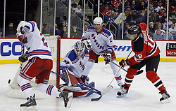 February 1, 2008; Newark, NJ, USA;  New Jersey Devils center Dainius Zubrus (16) shoots the puck wide of New York Rangers goalie Henrik Lundqvist (30) during the second period at the Prudential Center in Newark, NJ.