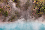 Steam rises from Inferno Crater, located in the Waimangu Volcanic Rift Valley on the North Island of New Zealand. The hot spring and other geothermal features resulted from the volcanic eruption of Mount Tarawera on June 10, 1886. The area was named for the Waimangu geyser, which was active from 1901 to 1904.