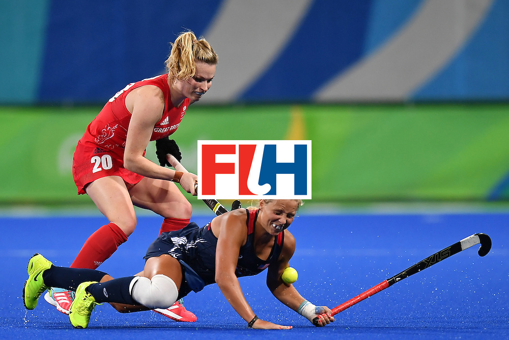 Britain's Hollie Webb (L) and USA's Kelsey Kolojejchick vie during the women's field hockey Britain vs the USA match of the Rio 2016 Olympics Games at the Olympic Hockey Centre in Rio de Janeiro on August, 13 2016. / AFP / MANAN VATSYAYANA        (Photo credit should read MANAN VATSYAYANA/AFP/Getty Images)