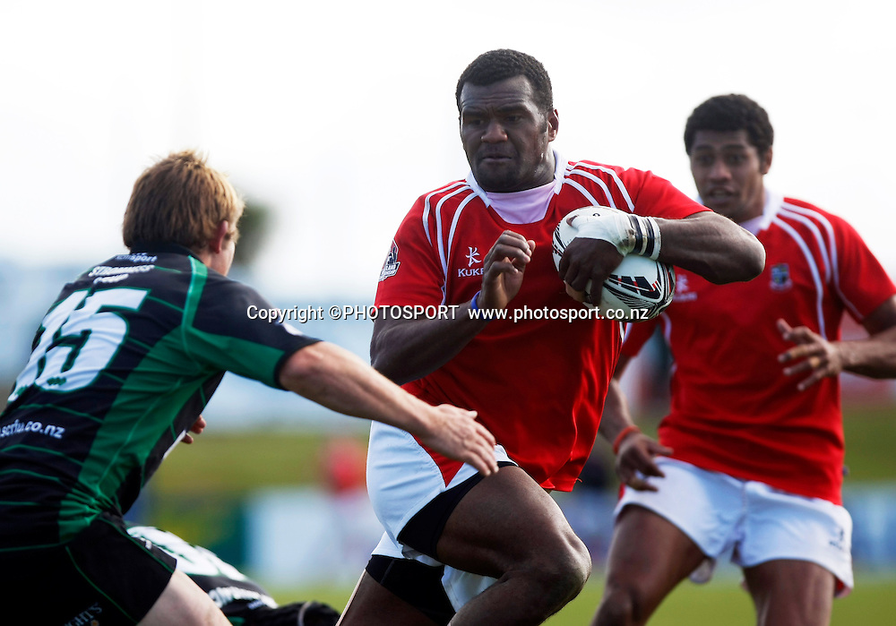 Paulo Tikomainaivalu with the ball for Poverty Bay in defence for South Canterbury is Jarred Trevathan during the Heartland Championship Lochore Cup Final between, South Canterbury v Poverty Bay at Alpine Energy Stadium, Timaru, South Canterbury. Saturday 8 October 2011. Photo : Joseph Johnson/photosport.co.nz