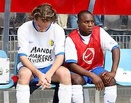 27-05-2007: Voetbal: VVV Venlo - RKC Waalwijk: Venlo<br /> RKC Waalwijk is gedegradeerd naar de Jupiler League.<br /> Oud VVV-speler Luwamo Garcia ziet zijn oud-collega's feestvieren terwijl Tim Janssen verslagne naast hem op de bank huilt van verdriet<br /> foto : Geert van Erven